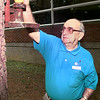 Date:   3/19/98-- Faces---Clarence Norton, a volunteer at the Longview Cancer Center, replaces the corn, Thursday morning, for the squirrels, so the patients receiving chemo can watch the wildlife during  treatment. Kevin green