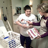 Date: 3/16/98--Eowyn Francis, left, holds her son Mariano Moore, while Amy Hill, right, with Community Health Clinic in Longview, brings donated baby items fro Eowyn, Tuesday morning at GSMC in Longview. Kevin green