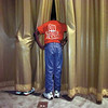 Big Sandy Chorale officer Gregory Strickland, 11, pokes his head between the auditorium curtains, Friday, to size up the crowd coming to honor the chorale on its upcoming trip to Washington, DC. The singers will depart ET on Sunday to sing on the Capitol steps. Matula photo.