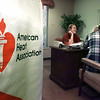 """03/31/98--Winzer Smith has a laugh as she listens to Jay Hurst solicit money for the American Heart Assn Tuesday evening at East Texas Professional Credit Union. The AHA had a """"teleparty"""" where high schoolers volunteered to call past donators and ask them to re-pledge. Matula photo."""