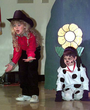 Date:   5/8/98----Lindsey Bryce, left, portrays Abby, and Cooper Puckett, right, portrays Buster during a dress rehearsal for Linda Snoddy and Donna Stagner's K-1 classes play of Abby Goes to Oz, Friday morning at White Oak Primary in White Oak. Kevin green
