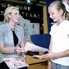 5/21/98---Miss Texas Reagan Hughes, left, hands an autographed picture to Whitney Trimble, right, after speaking to the students at Harmony Middle School Thursday afternoon in Harmony. kevin rgeen