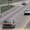 Date:   5/7/98---Bank robbery suspect is being pursued by Texas DPS and Harrison County and other authorities as he passes under East Loop 281 on I-20 Thursday afternoon outside of Longivew Tx. Kevin green