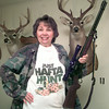 Date:   11/25/98---Evelyn Parker holds her Marlin 30-30 rifle as she stands in front of her 15 point buck she shot in 1986 Wednesday afternoon at her home in Longview. Kevin green