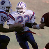 11/21/98---Daingerfield running back Montoya Brown (22) eyes the endzone as he rounds the corner on a run as teammate Montral Walker (10) prepares to block White Oak's Travis Harris (20). Brown had three long touchdown runs in the first quarter to put his team up for good. bahram mark sobhani