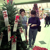 "11/27/98---Jena Crim, right, and her daughter Maggie of Kilgore choose an ""Angel"" from the Salvation Army Angel Tree at Longview Mall Friday. The Crims choose a boy and girl every year to give gifts to. bahram mark sobhani"