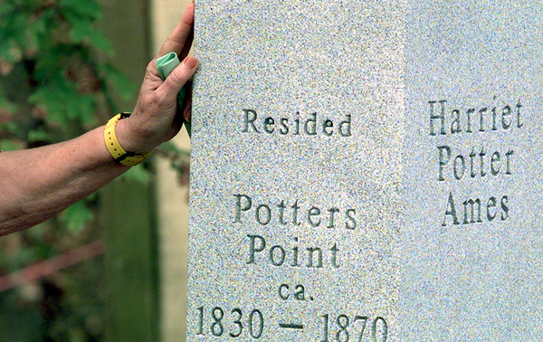 11/28/98---A lady's hand reaches out to touch the new memorial dedicated to Harriet Potter Ames. bahram mark sobhani