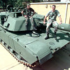 Date:   9/24/98---SPC Robert Dole, left, and SFC Ben Gurganus, right, sit atop the Co B, 5thBN, 112th ARMOR newest addition to the fleet a M1A1 main battle tank Thursday afternoon at the National Guard Armory in Longview. Kevin green