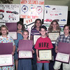 9/22/98---Longview ISD fifth graders show the certificates they received at Tuesday's city council meeting for being winners in the 911 Day poster contest.  From left are Lydia Nowell, Megan Ritchey, Jennifer Nibel, Barbara Linch, Adam Vaughn, Kayla Lammbert and Kollin Huddleston. bahram mark sobhani