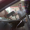 8/11/99---David Richardson washes a window at Fourth Street Texaco. Only a few full-service gas stations remain in the area. bahram mark sobhani
