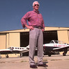 8/2/99---Astronaut Eugene Cernan stands in front of two of his planes at Aerosmith Aviation's hanger at the Gregg County Airport Mondaymorning. Kevin green