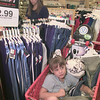 8/6/99---Sarah Smith, 5, gets comfy in the shopping cart as her mother, Vicki, rear, shops for clothing Friday at Target in Longview. Vicki Smith said she had waited for the tax-free weekend to buy back-to-school clothes. bahram mark sobhani