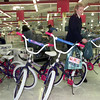 12-21-99---Capt. Connie Tharp, with the Salvation Army, lines up bicycles they purchased Tuesday morning as they finish the buying some last gifts for the Angel Tree at the Wal-Mart Supercenter in Longview. Kevin Green