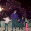 12-22-99--Terry Kenyon, center, ice skates with his twins Brooke,9, left, and Zachary, 9, right, Wednesday night in Marshall. kevin Green