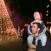 12/3/99---Derek Voorhees carries his son, Bylan, 4, on his shoulders as the two take in the holiday lights at the Gregg County Courthouse Friday night at the official lightup ceremony. bahram mark sobhani