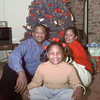 12/15/99---Pastor T. Ray McJunkins sits with his wife, Dietra and daughter Chelsea in their home. bahram mark sobhani