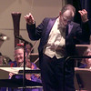"12/30/99---Conductor Tonu Kalam beckons the audience to join in with clapping during the final piece of the Longview Symphony Orchestra's ""A Night in Old Vienna"" Thursday night."