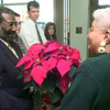12-15-99---Donors Left to Right---Rev. Levi Wright, Jason Hunt, Rev Jeffery Roadcap, and Gina Jackson, watch as Because I Care minority recruiter Margaret Parker presents Rev Wright with a poinsettia during a press conference at Stewart Regional Blood Center in Longview. Kevin GReen