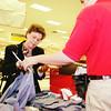 Barbara Folks of San Antonio returnes Christmas clothing to clerk Daniel Tenbrook at the Target on loop 281 Sunday afternoon. Obie LeBlanc.