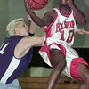 12/9/99---Kilgore's Justin Henderson (10) goes up and around the outstretched arms of Dallas Heritage Academy player Randall Hutto in the first quarter of their game in the Oil Belt Classic. bahram mark sobhani