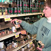 12-29-99---Ann Heidt, of Longview buys several cans of black-eyed peas as she prepares for the January the first, Wednesday afternoon at Albertson's in Longview. Kevin Green