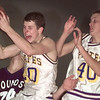 12/9/99---Pine Tree's Adam Maples (20) screams as he hauls in a rebound as teammate Jameson Turner (40) backs off in their win over Peaster in the Oil Belt Classic. bahram mark sobhani