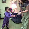 12-3-99---Sierra, left, walks to her mother Amanda at grandmom's Juanita Haynes home in Longview. Kevin GReen