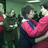 2/12/99---Alice Day, right, is hugged and talked to by Doris Cummings as other people wait their turn to talk to Day at a reception to honor her Friday at the Longview Drug Task Force offices. Day is resigning from her job as program manager for the drug task force.
