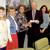 2/1/99---At center, Hospice Longview Executive Director Ed Arneson accepts a $1,500 donation passed from Bonnie Berg of Sam's Club. Flanking them are, from far left, Sam's Club representatives Pam Smith and Darla Jones and, from far right toward Arneson, Lynn Bryson and Lisa Jones of Hospice Longview. glen evans