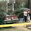 Date:   1/7/99---Residents from the Frank street area starting with the home owner where the crash occured, left, Irene Traylor, and neightbor Gail Allison, center, and an unidentified relative, right,  in Marshall survey the scene where two suspected bank robbers from Longview escape's ended after a chase when the suspects lost control and hit a house at 2302 Frank St. Kevin green