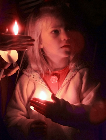 1/22/99---Katie Pope, 5, looks up from her candle during a vigil Friday night at St. Mary's Catholic Church, where a mock cemetary is set up to represent children who are aborted each day in Texas. The vigil was held for the unborn on the anniversary of the Roe v. Wade decision. bahram mark sobhani
