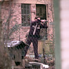 Date:   1/7/99---A Harrison County Deputy continues a manhunt with his weapon drawn in a neighborhood as they search for the bank robbery suspects in Marshall. Kevin green