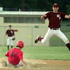 7/8/99---White Oak's (20) leaps over a sliding Sabine's (31) in order to catch the pickoff throw at second base. (31) was safe and went on to score in the second inning. bahram mark sobhani