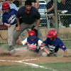 7/15/99-Longview National player Zane Hendon slides into home and Marshall pitcher Richard Parott attempts to tag him out as a teammate and the umpire watch.  Jessica Williamson