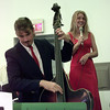 7/12/99-Bass player, Kevin Kelly, strums out a tune while songstress, Bethany Johnson, sings along as part of the Sounds of Swing band.  Jessica Williamson