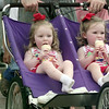 6/5/99---Jenny and Susie Loome, 3, kick off their shoes and try to cool off with ice cream Saturday as they wheel through AlleyFest. bahram mark sobhani