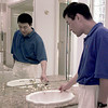 6-20-99  Dr. Randy Zhang examines workmanship in one of the bathrooms at the Parade of Homes no.14 house house at 2022 Centinairy built by D+D Custom Homes of Longview. Obie LeBlanc