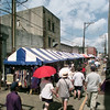 6/5/99---Patrons fill Bank Alley as they look at vendors' booths Saturday during AlleyFest. bahram mark sobhani