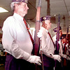 5/30/99--E.L. Jr Chatham, left, a WWII Army Vet. holds a rifle salute during hte posting of the colors Sunday afternoon at the American Legion Post 301 where Max Sandlin spoke during a Memorial Day celebration in Longview. Obie Le Blanc