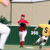 5/15/99---Carthage second baseman Sturart Lipsey (5) makes the throw to first after tagging Little Cypress-Mauriceville runner Chad Kemp (5) on a double-play ball during their game. The runner was safe at first. bahram mark sobhani
