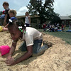 5/17/99---Brittney Fitts digs in the sand during beach day Monday at Spring Hill Elementary School. Kindergarteners from the school spent the afternoon playing in sand and water and doing crafts. bahram marks sobhani