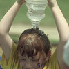 5/17/99---Stephanie Harper douses herself with a jug of water during beach day at Spring Hill Elementary School. The annual event is held for kindergarteners to help wind down the last week of school. bahram mark sobhani