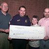 11/16/99---LPD Chief A.J. Key, far left, and officer James Johnson accept a check Tuesday for the LPD bicycle patrol for $2102.61 from TROLS board members Kim Cook and Rick Callaway. The Tandem Riders of Longview (TROLS), a splinter group of the Longview Bicycle Club, raised the money in September at a three-day tandem bike rally in Jefferson. bahram mark sobhani