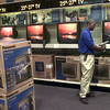 11-10-99---Donnell Burwell, the home theater deptment supervisor at the new Best Buy, checks inventory while tv's wait in the floor to be stocked Wednesday afternoon on Loop 281 in Longview. Kevin GReen