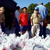11/13/99---Members of Boy Scout Troop 200 get ready to load bags of food collected Saturday during the Scouting for Food Drive. From left are Robert Deller, Adrian Zapata and John Eric Zapata. Food was delivered to the Maude Cobb Activity Center to be distributed during the Community Thanksgiving Food Drive on Nov. 23. photo by Ana Walker.
