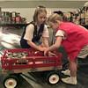 11/23/99---Laura and Emily Woody sort canned goods Tuesday at the annual citywide food drive at the Maude Cobb Convention and Activity Center. bahram mark sobhani