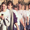 11/18/99---Big Sandy volleyball players walk to their bus early Thursday as they leave for the State Volleyball Tournament in Austin. Students from Big Sandy School lined the parking lot for the players to walk through. bahram mark sobhani