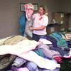 10-28-99-- Lonnie Clark, with ABC Auto parts in Longview, sorts coats for the Coats for Kids drive Thursday morning on HWY 80 in Longview. Kevin GReen