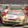 NASCAR driver Terry Labonte's pit crew is busy during a pit stop during the Primestar 500 at TMS in Ft. Worth, Texas. Kevin Green