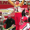 NASCAR driver Terry Labonte stands on his car in the winner's circle after winning the Primestar 500 at TMS in Ft. Worth, Texas. Kevin Green